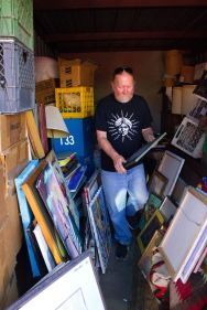 Natalia V. Navarro/For the Arizona Daily Star, Steve Purdy goes through a locker full of thrift store art in preparation for an exhibit Saturday. He had the idea for the show six years ago while traveling for his record label. bit.ly/2dhl7ex